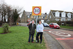 Anne-Marie helps Cllr David Towns get new speed signs for Widdrington Station